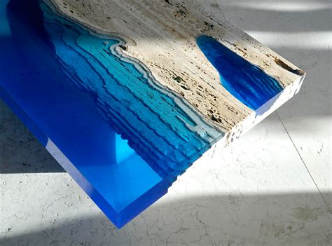 Meja Epoxy cut travertine marble and resin merge to create lagoon tables colossal