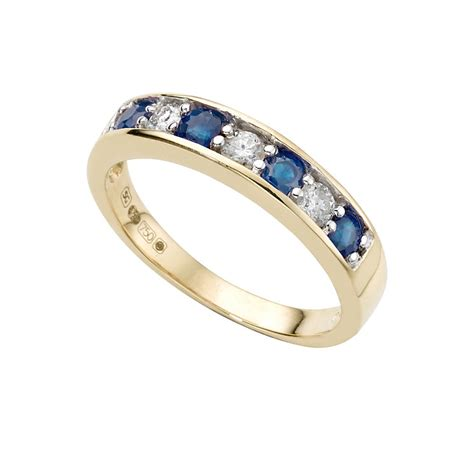 Ruby 7 20 Ct 18ct gold sapphire and 0 20ct half eternity ring