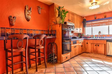 kitchen with terracotta tile floors l shaped in