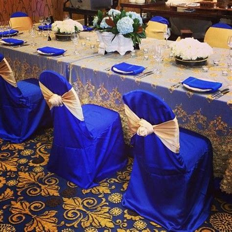 beautiful royal blue and gold table linen at the 2013