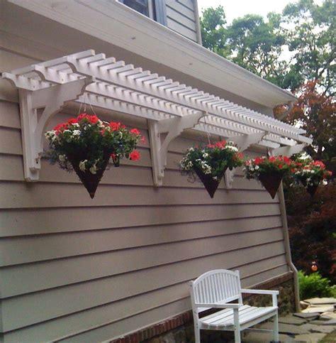trellis overhang  hanging baskets outdoor decor