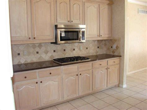 How To Paint Stained Kitchen Cabinets White Staining Oak Cabinets White Deductour