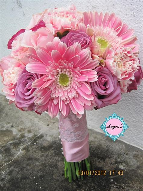 roses carnations gerbera daisies  add calla lilies