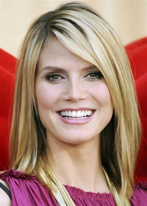 Heidi klum medium length hairstyle straight haircut with side bangs