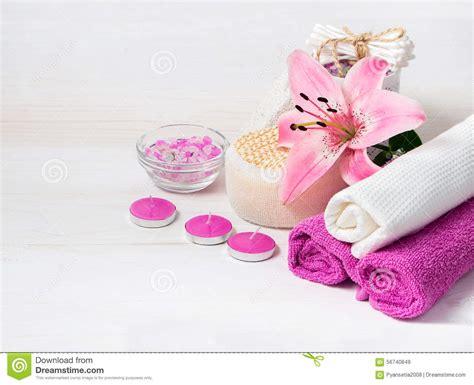 a fiori spa spa concept pink flower sea salt candles towels