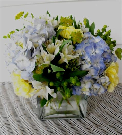 blue and yellow centerpieces centerpieces a in bloom event floristry