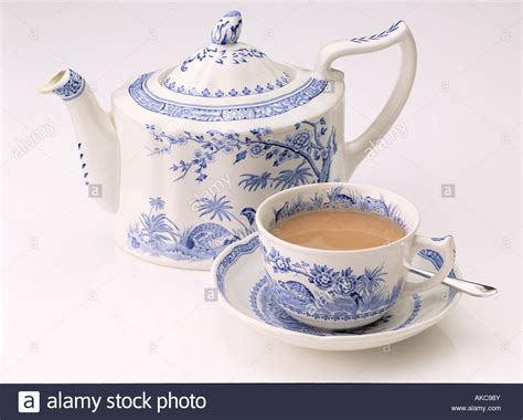 an antique wedgwood teapot cup and saucer of tea on a