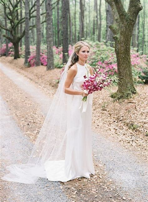cameran eubanks in wedding dress holding purple orchids http itgirlweddings cameran