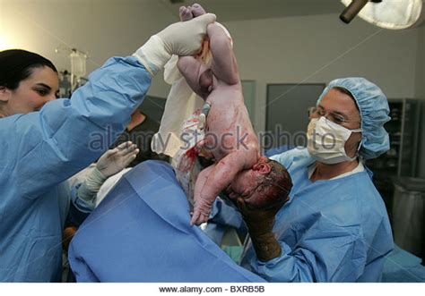 virginal birth after c section newborn operating room stock photos newborn operating