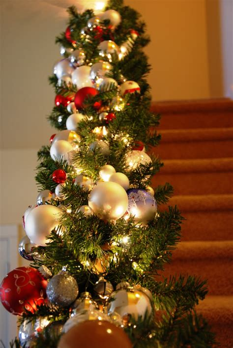 christmas garland on banister christmas banister christmas decoration ideas pinterest