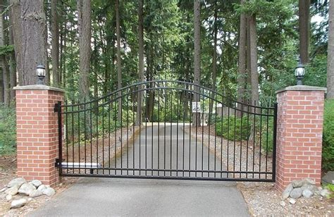 driveway swing gates single swing gate with posts wrapped in brick masonry