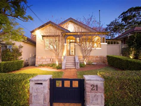 1950s house renovation ideas australia rendered brick californian bungalow house exterior with hedged fence hedging house