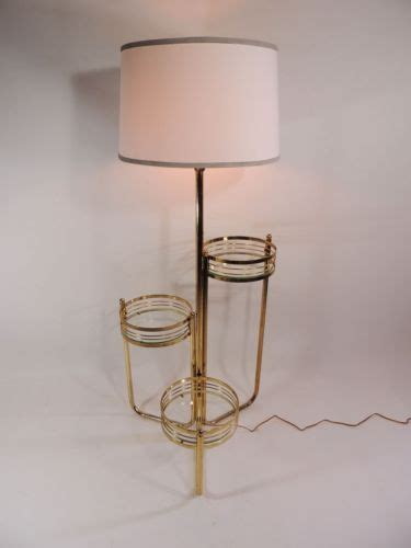 floor ls with attached table mid century modern brass floor l stand w 3 attached