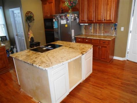 sienna beige granite on medium colored wood cabinets 4 9