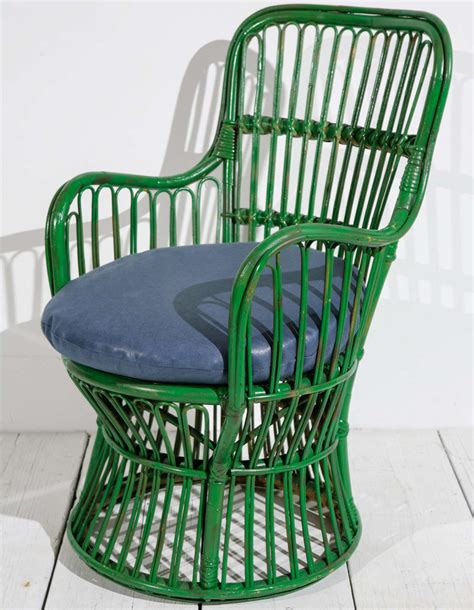 green wicker armchair in the style of gio ponti and lio