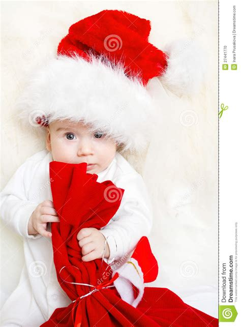 red santa sack for babies pictures baby holding bag in hat stock photo image 27441770