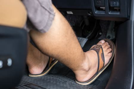 Do You Drive Shoeless by Is It Illegal To Drive While Barefoot Or Wearing Flip