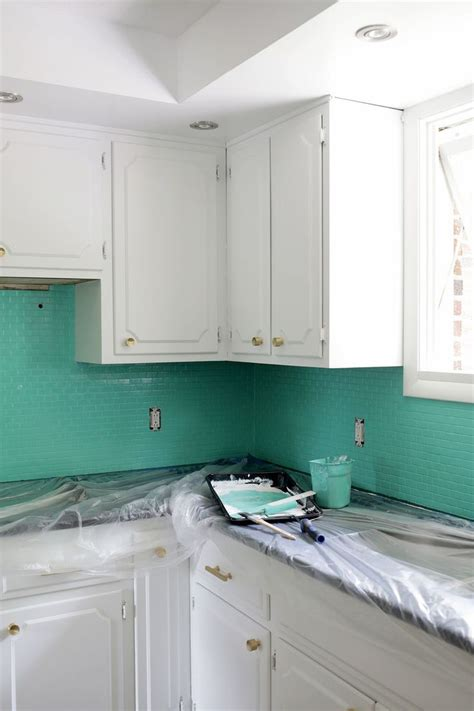 How To Paint Tile Backsplash In Kitchen 25 Best Ideas About Painting Tile Backsplash On Pinterest Painting Tiles Painted Tiles And