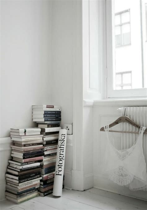 book stacking ideas scandinavian home decor that proves less is more stylecaster