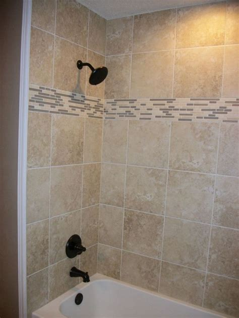 shower surround in square tile with linear tile border n