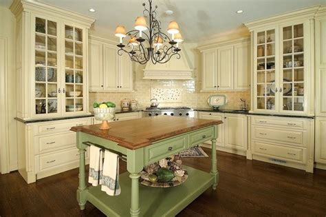 Two Tone Cabinets Kitchen by French Country Style Kitchen With Cream Cabinets And A Wrought Iron Chandelier Discovered On