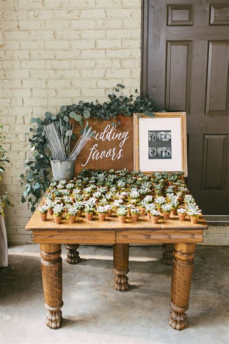 wooden table wedding favors stand mini potted succulents