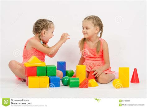 Girl Frighten Another Girl Playing With Blocks Stock Photo