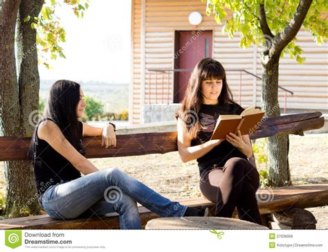 women bench two women siting on bench royalty free stock image image