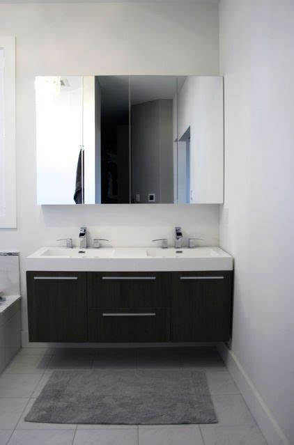 from Houzz: Two Ikea mirrored medicine cabinets are hung