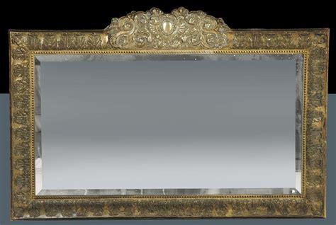 ste con cornice specchiera con cornice in argento sbalzato xviii secolo