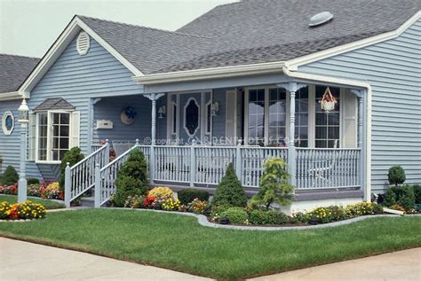landscaping around house foundation curb appeal blue house lawn foundation plantings flowers entrance garden front