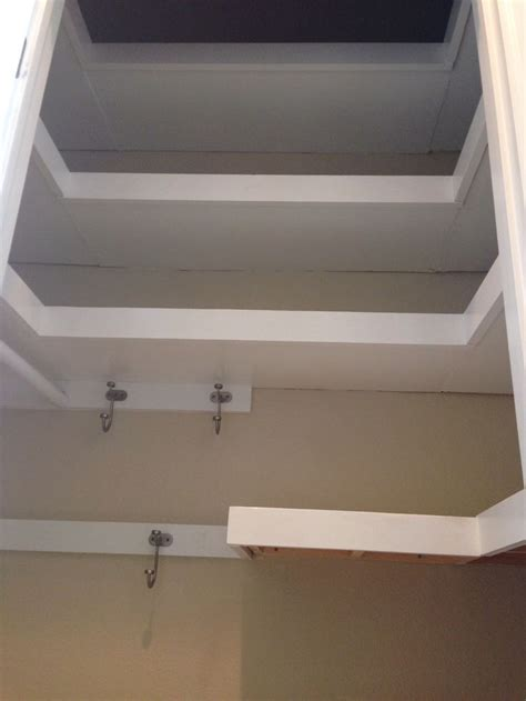 u shaped floating shelves in hall closet finished diy