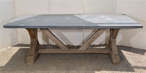 blue top dining table made from reclaimed pine at