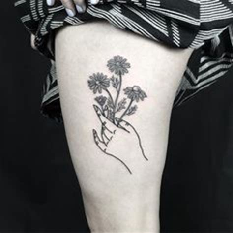 tattoo of a hand holding flowers fashion on pinterest modcloth pixie cuts and short