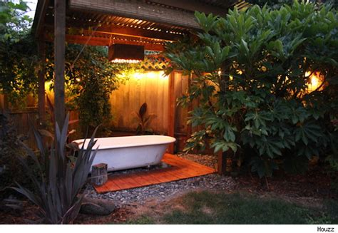 how to turn your backyard into an oasis use a salvaged tub to turn your backyard into a soothing oasis