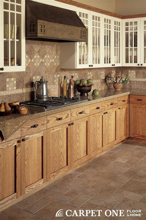 coordinating wood floor with wood cabinets gorgeous tile flooring and coordinating backsplash