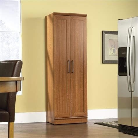 sauder kitchen cabinets homeplus storage cabinet in oak finish 411963