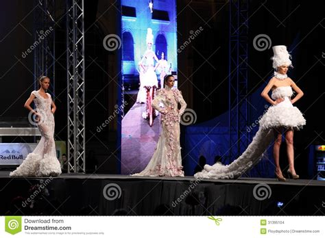 fashion models   stage wearing white dresses