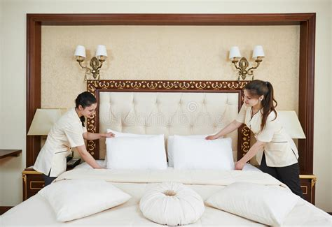 bed making by the staff picture of hotel goldi sands chambermaid woman team at hotel service stock photo