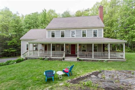 colonial house with farmers porch garrison colonial style exterior remodel the great