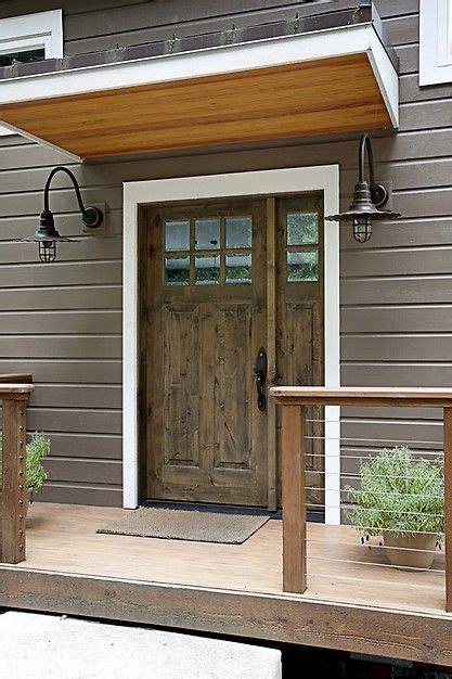 simple stunning front door design  iron sconces