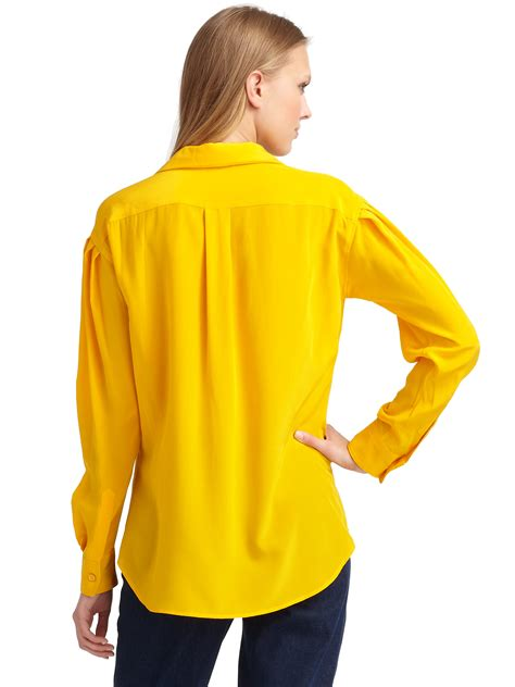 Yell O Blouse lyst moschino silk button blouse in yellow