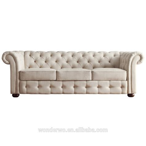 beige tufted sofa line upholstered classic scroll arm button tufted