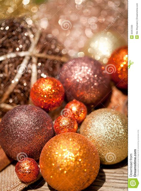 glittering christmas decoration in orange and brown