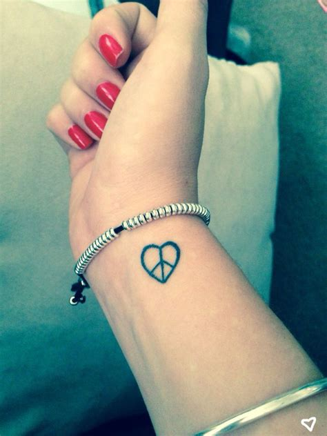 small love heart tattoo peace small wrist