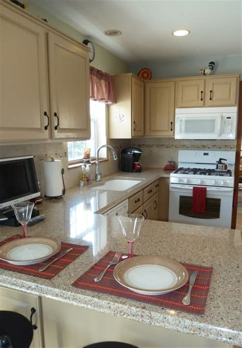 Painted Kitchen Cabinets With White Appliances by Compact Kitchen With Painted Cabinets And White Appliances
