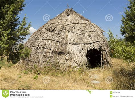 traditional straw hut in greek country royalty free stock