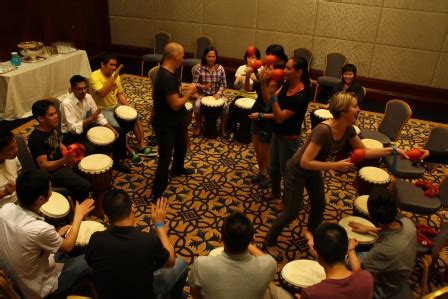 rhythm drum game drumming team challenge in macau where guests create