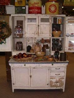 old white hoosier with yellow ware bowls bitchin in hoosier cabinet roosters pinterest hoosier cabinet