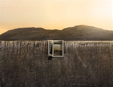 a house built casa brutale from opa is an architectural house carved into the edge of a cliff